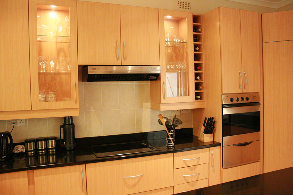 Beach Melamine kitchen with electric hob, eye level oven and glass units