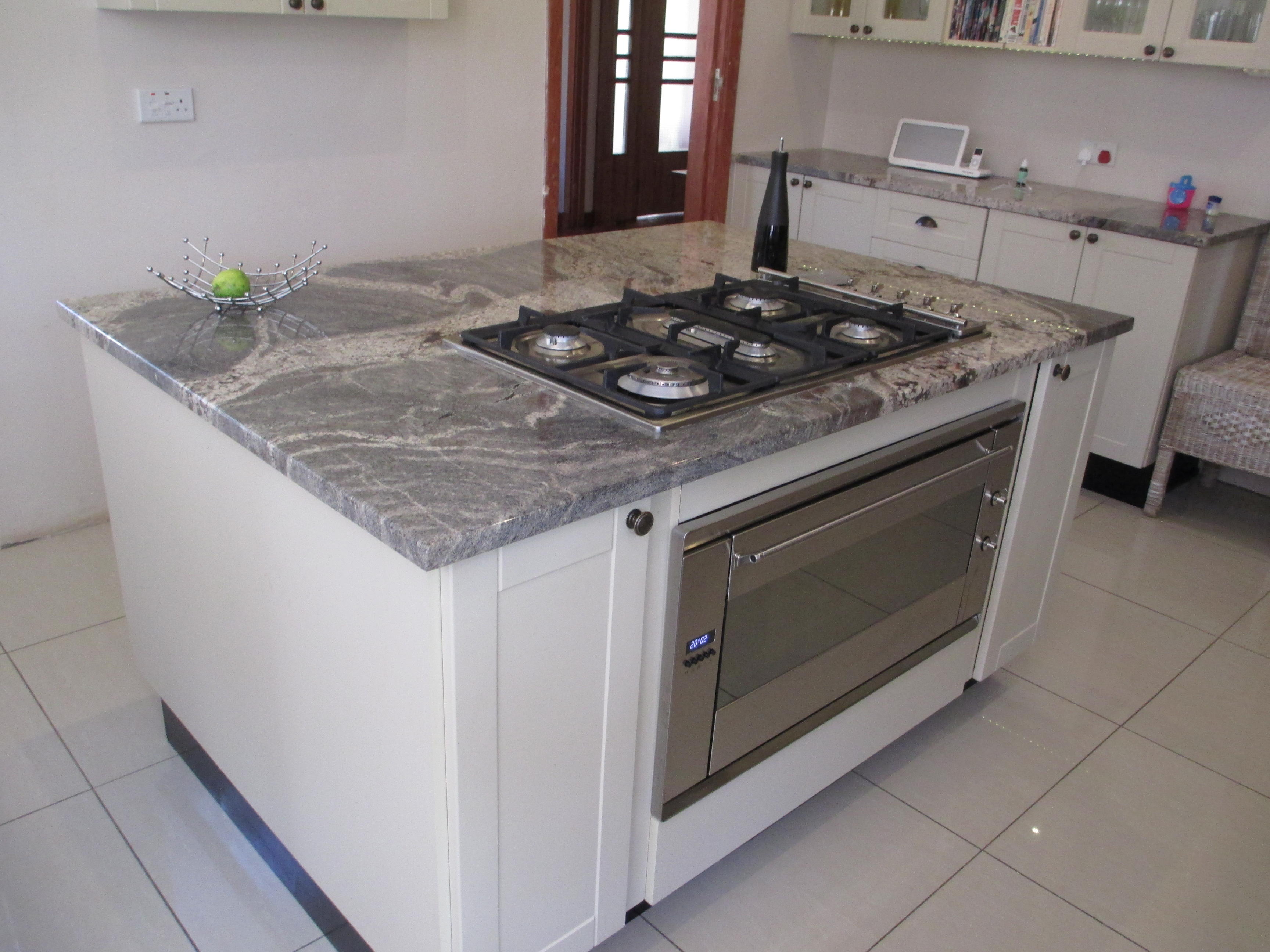 Cappuccino PVC Wrappe Kitchen  with Smeg appliances and push to open mechanisms