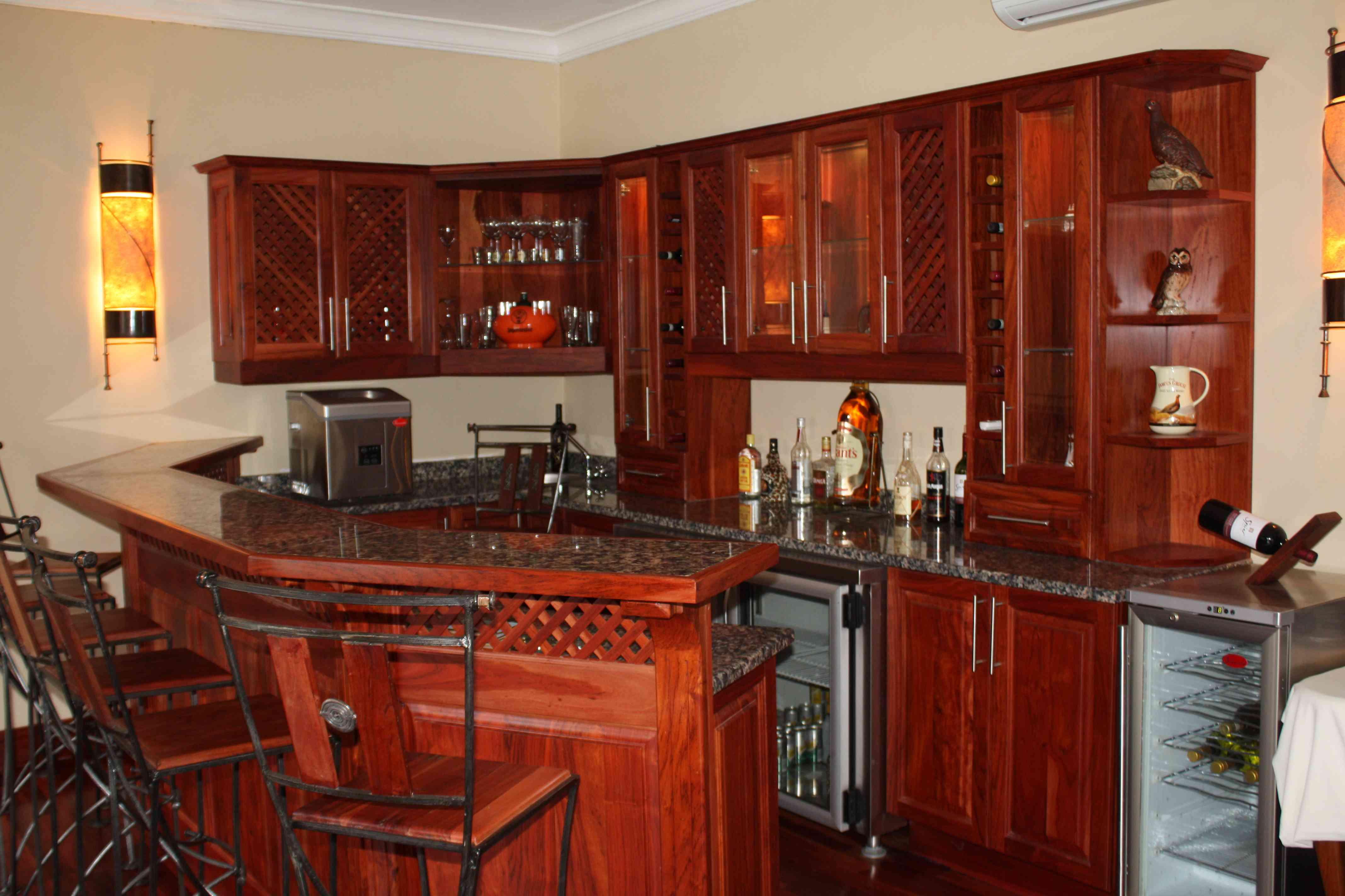 Natural Zimbabwean teak bar with raised panel doors and local Zimbabwean granite counter tops