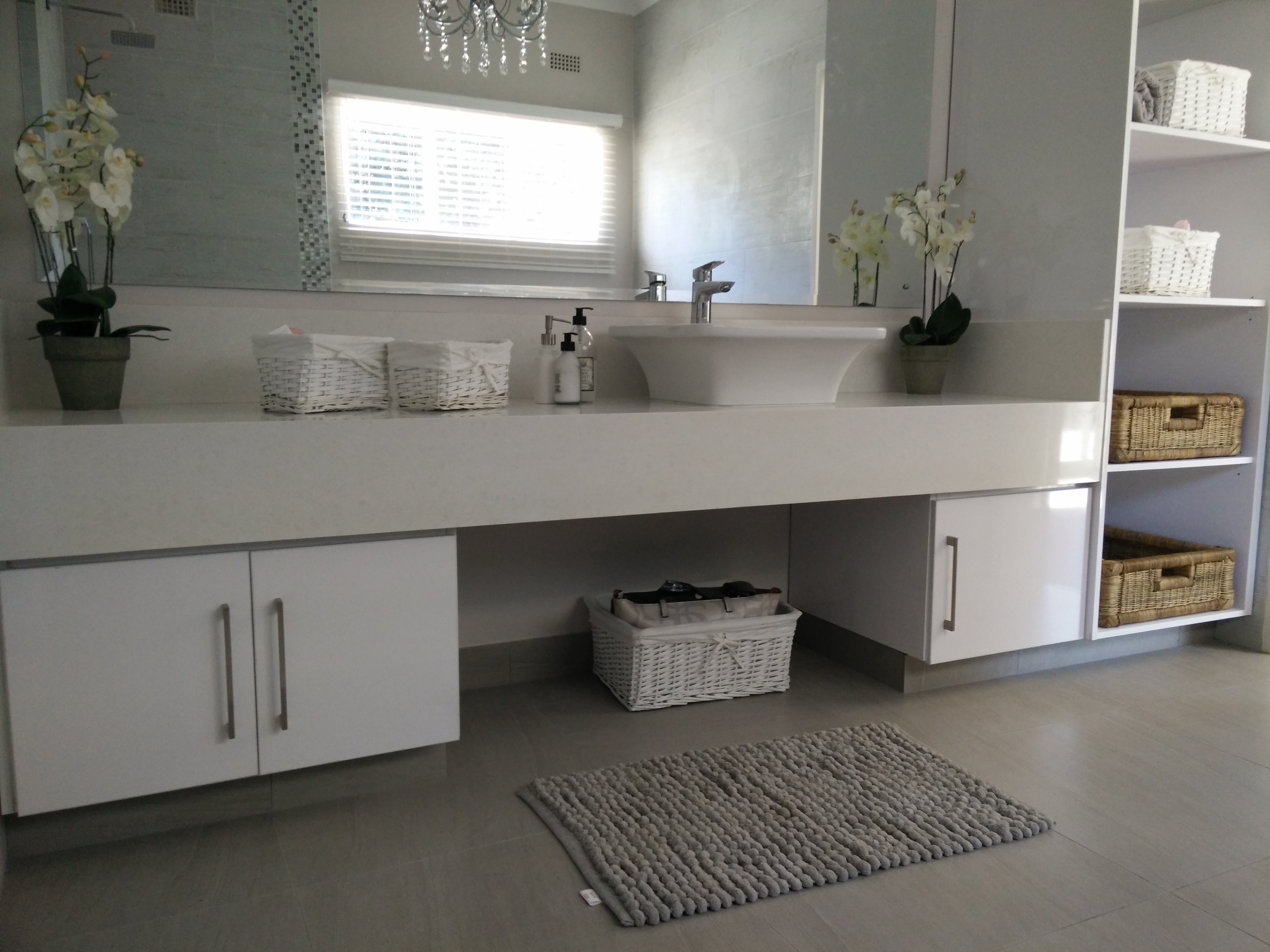 High gloss white vanity unit with white ceaserstone countertop